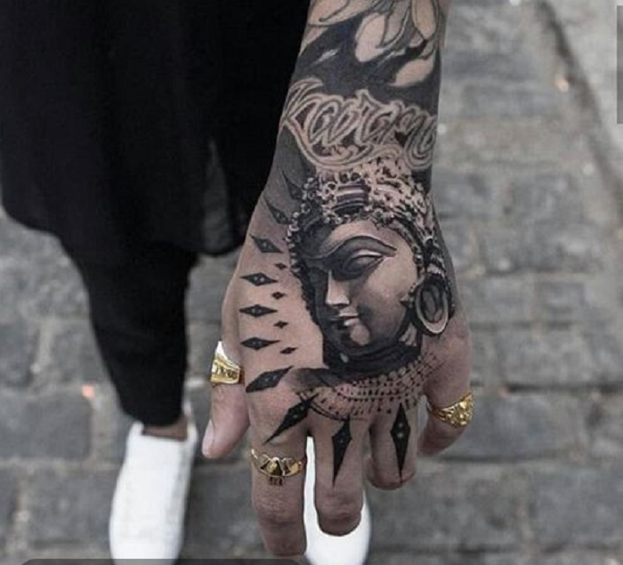 Hình xăm Phật đẹp cho mu bàn tay